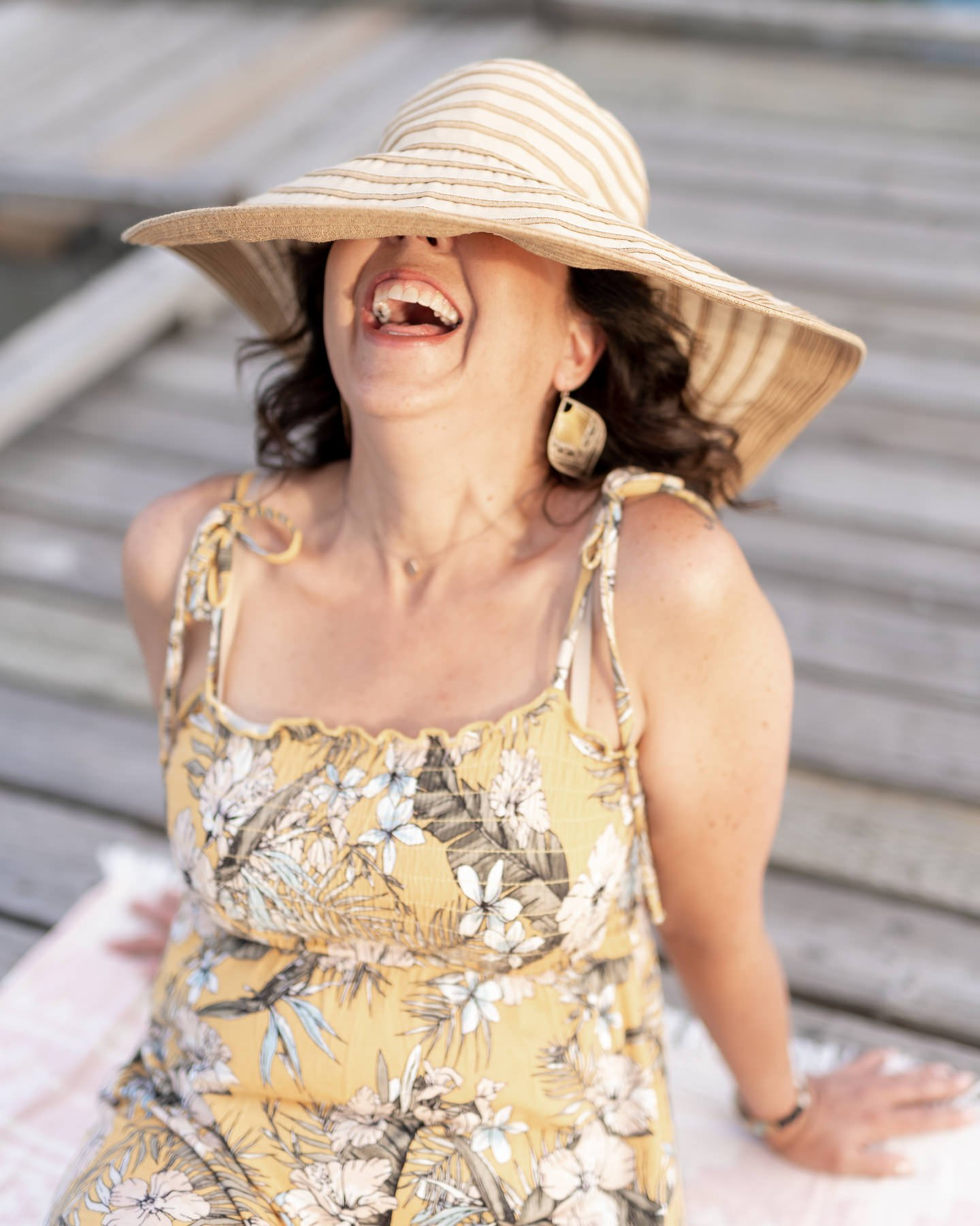 laughing in a hat lifestyle photos