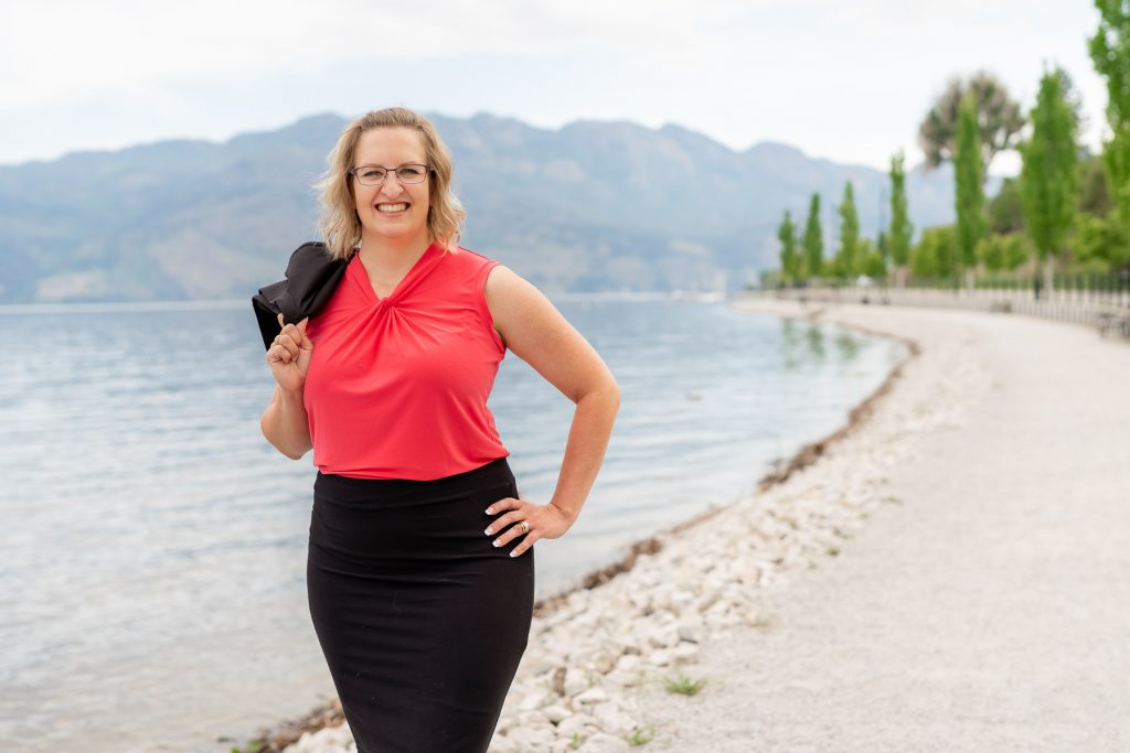 business woman photography in front of lake