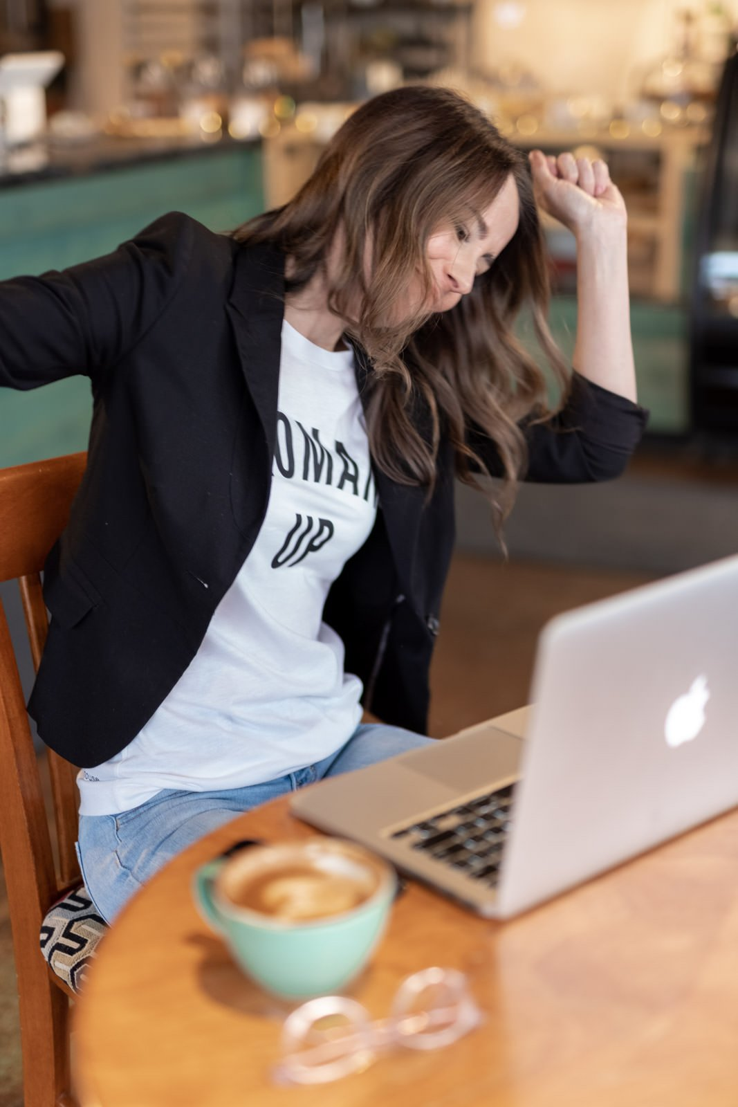 woman dancing in her chair for persona branding photoshoot